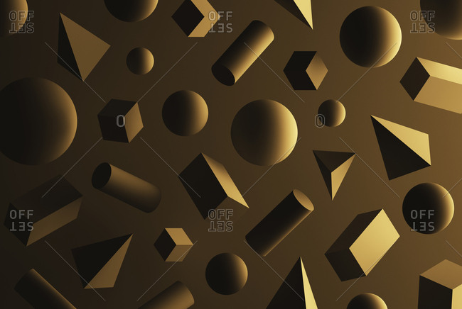 Cubes, pyramids, spheres and cuboids in front of brown background