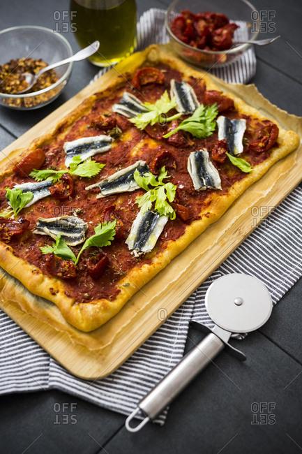 Pizza Marinara garnished with anchovies and parsley