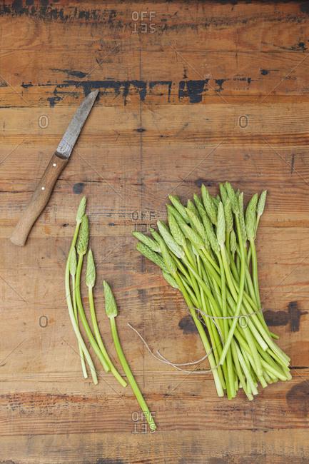Green wild asparagus on wood