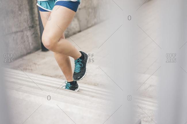 Close-up of woman running upstairs