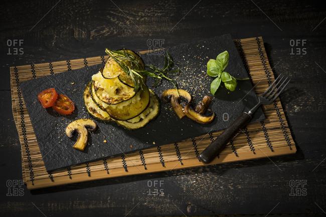 Vegan layered tower, potato mash, aubergine, zucchini and champignon