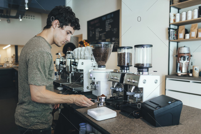 Barista preparing coffee in a coffee bar
