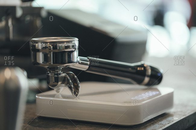 Strainer of espresso maker in a coffee bar, close-up