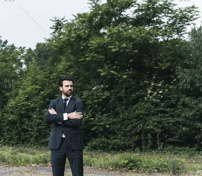 Businessman standing in remote landscape