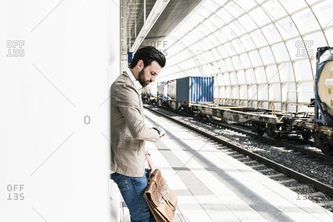 Young man waiting at the station platform