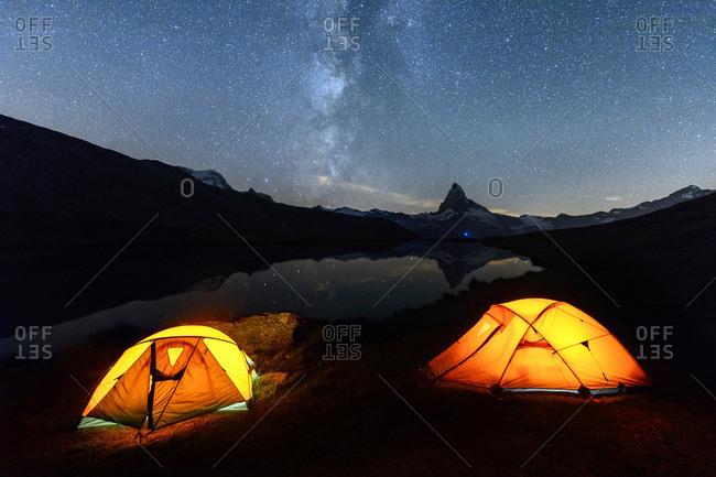 Camping under the stars with Matterhorn reflected in Lake Stellisee, Zermatt, Canton of Valais, Pennine Alps, Swiss Alps, Switzerland, Europe