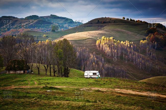 Caravan in autumn landscape, Apuseni mountains, Romania, Europe