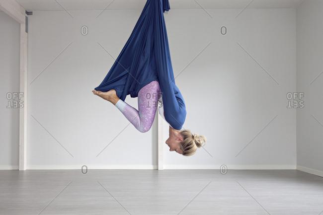 Woman upside down in folded position