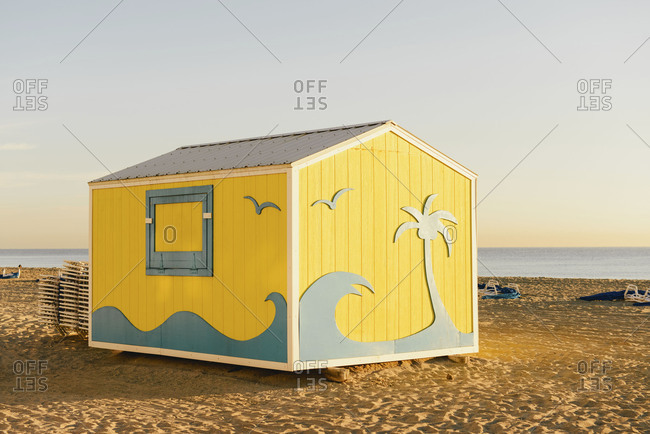 Small decorated building on sandy beach