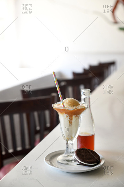 Ice cream float served with cookie