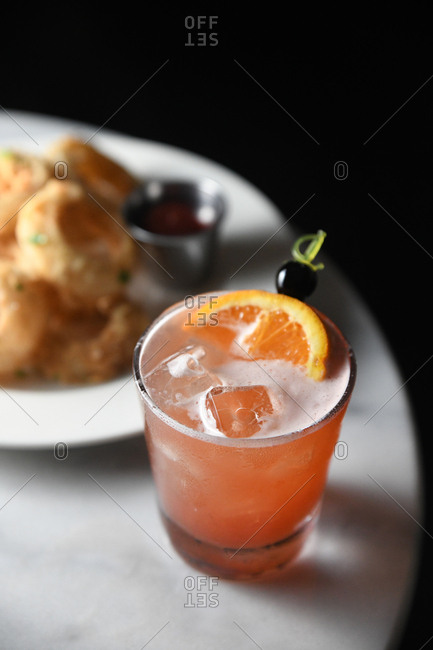 Orange cocktail served with food