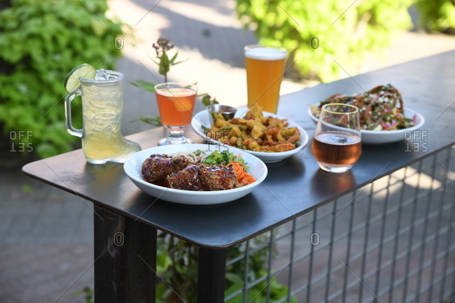 Outdoor table with food and cocktails