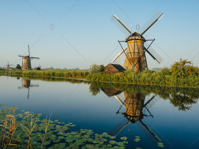 Three traditional Dutch windmills in the Netherlands