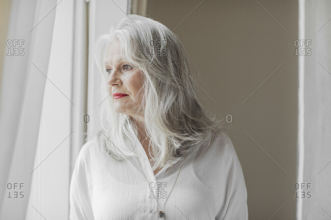 Portrait of grey-haired beautiful senior Caucasian woman