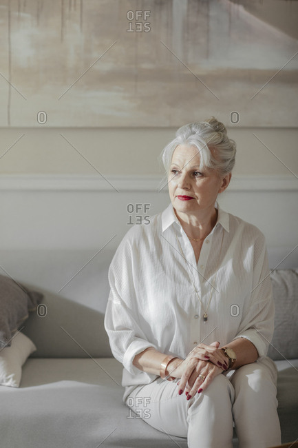 Portrait of pretty grey-haired senior Caucasian woman