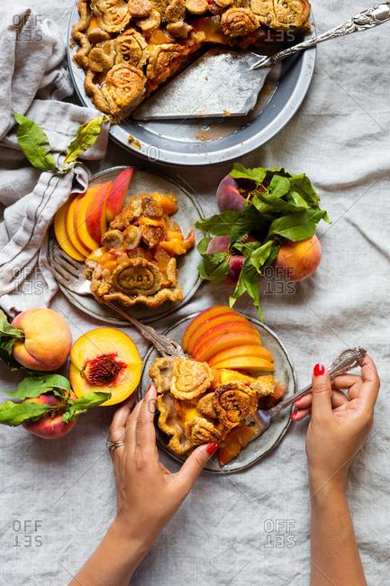 Woman eating gluten free peach pie