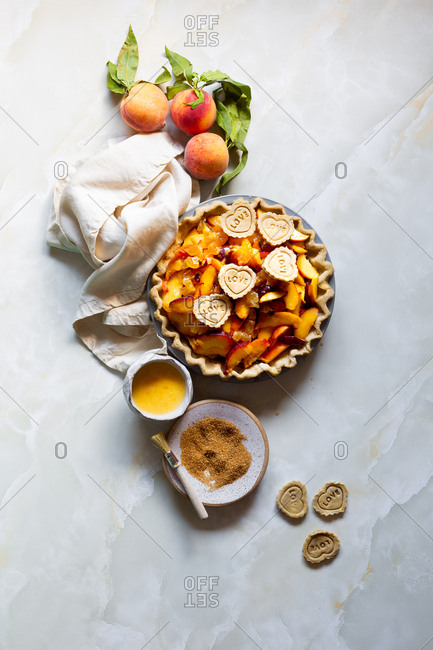 Homemade peach pie with heart cutouts