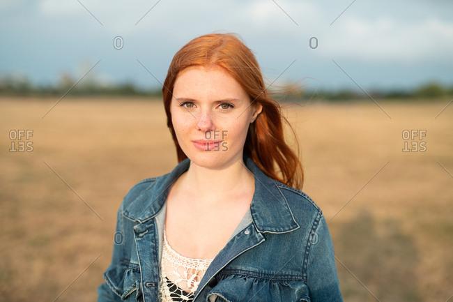 Portrait of young redhead teenage girl wearing jean jacket