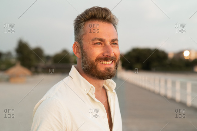 Happy man with facial hair on boardwalk