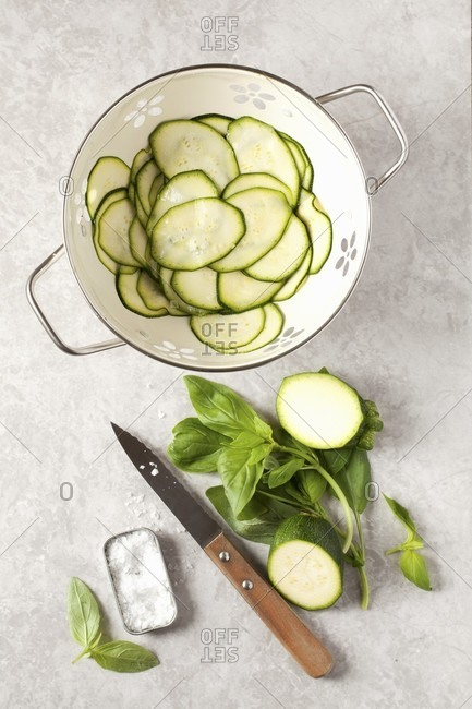 Salted courgettes for a courgette and basil salad