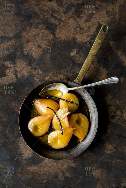 Caramelized poached pears in a pan (seen above)