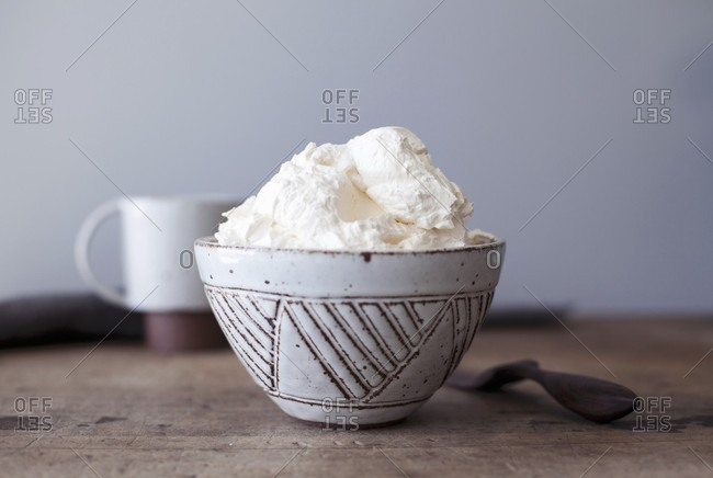 Whipped cream in a ceramic bowl