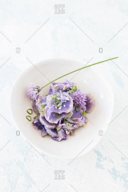 Purple potato salad with chive flowers