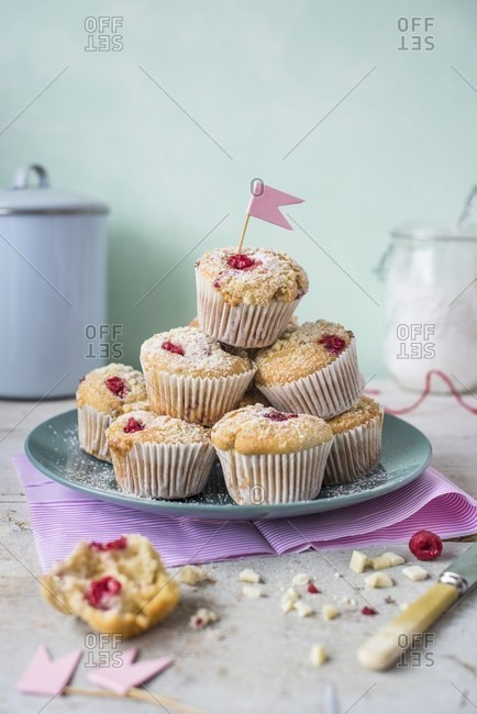 Raspberry muffins with white chocolate on a plate