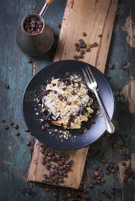 Waffles with a chocolate and coffee sauce, almonds and hazelnuts