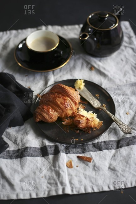 A croissant and black coffee