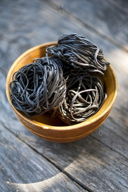Pasta nests made of black sepia pasta in a bowl