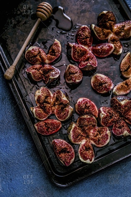 Roasted figs with honey on a baking sheet