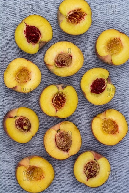 Several nectarine halves (seen from above)