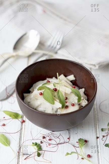 Sage and cream cheese sauce with pasta and pink peppercorns