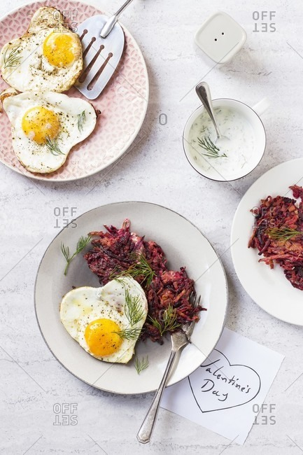 Beetroot and carrot fritters with heart-shaped fried eggs for Valentine's Day