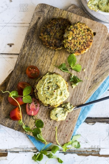 Quinoa fritter with avocado dip on a chopping board