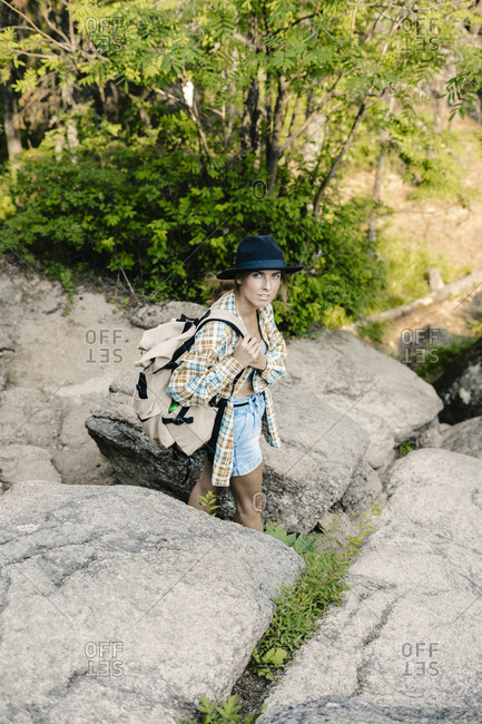 Young woman backpacking in the Stolby Nature Sanctuary