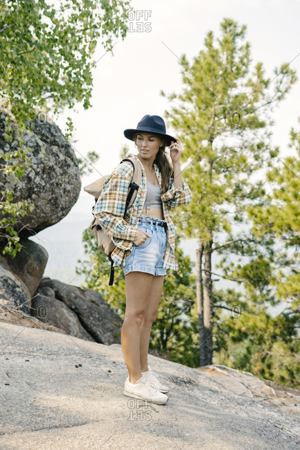 Young woman backpacking on mountain in the Stolby Nature Sanctuary