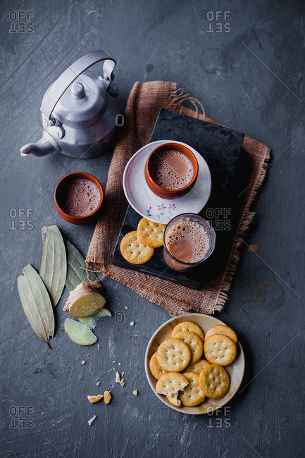 Freshly brewed tea served with snack crackers