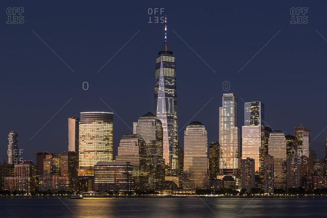New York City, USA - July 19, 2018: Lower Manhattan skyline at sunset view from Hudson riverside