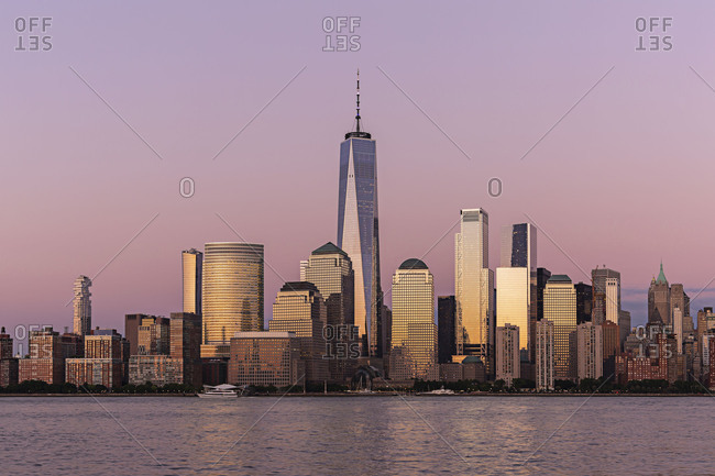 New York City, USA - July 19, 2018: Lower Manhattan skyline at sunset view from Hudson riverside