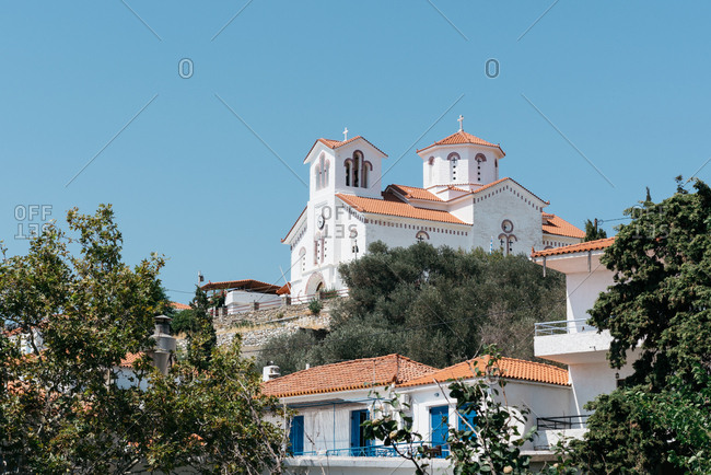 Large white church with tiled roof on the island of Andros