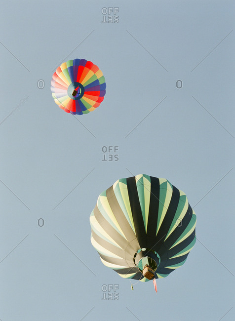 Two colorful hot air balloons from below