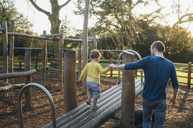 Father and son on playground