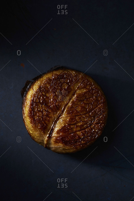 Cabbage bread on black surface