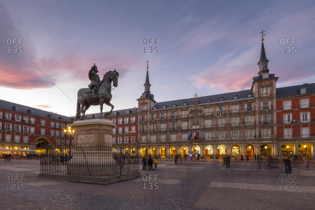 March 27, 2018: View of Philip lll statue and architecture in Calle Mayor at dusk, Madrid, Spain, Europe