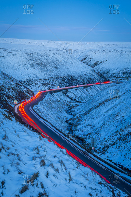 Winter landscape and trail lights on Snake Pass, Peak District National Park, Derbyshire, England, United Kingdom, Europe