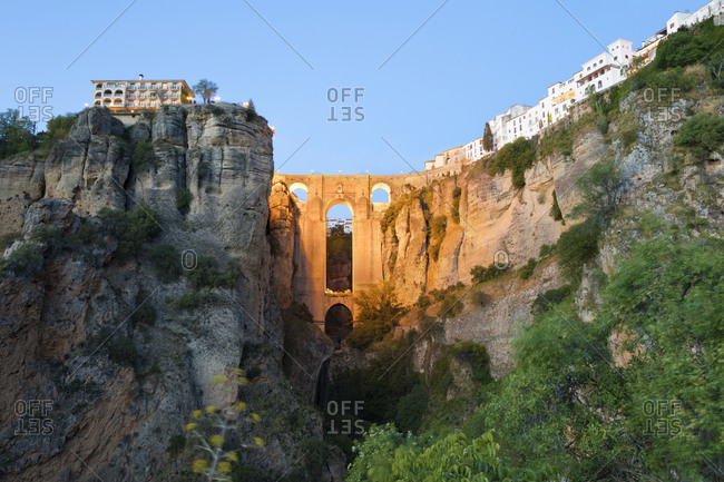 Puente Nuevo (New Bridge) floodlit at night and the white town perched on cliffs, Ronda, Andalucia, Spain, Europe