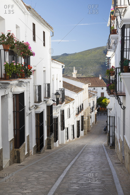 May 1, 2017: Narrow street in Andalucian white village, Zahara de la Sierra, Sierra de Grazalema Natural Park, Andalucia, Spain, Europe