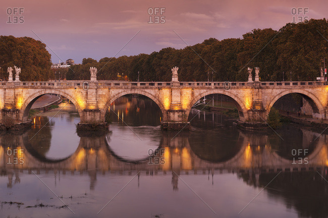 Ponte Sant'Angelo Bridge reflected in Tiber River at sunset, Rome, Lazio, Italy, Europe